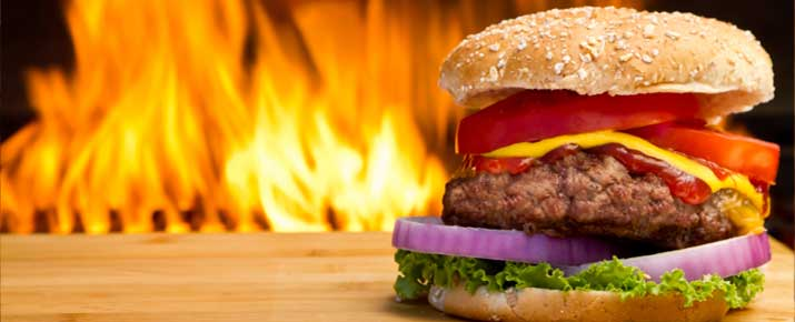 Beef Burger in front of Barbecue Flames